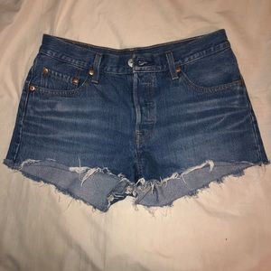 Medium wash 501 Levi's shorts.